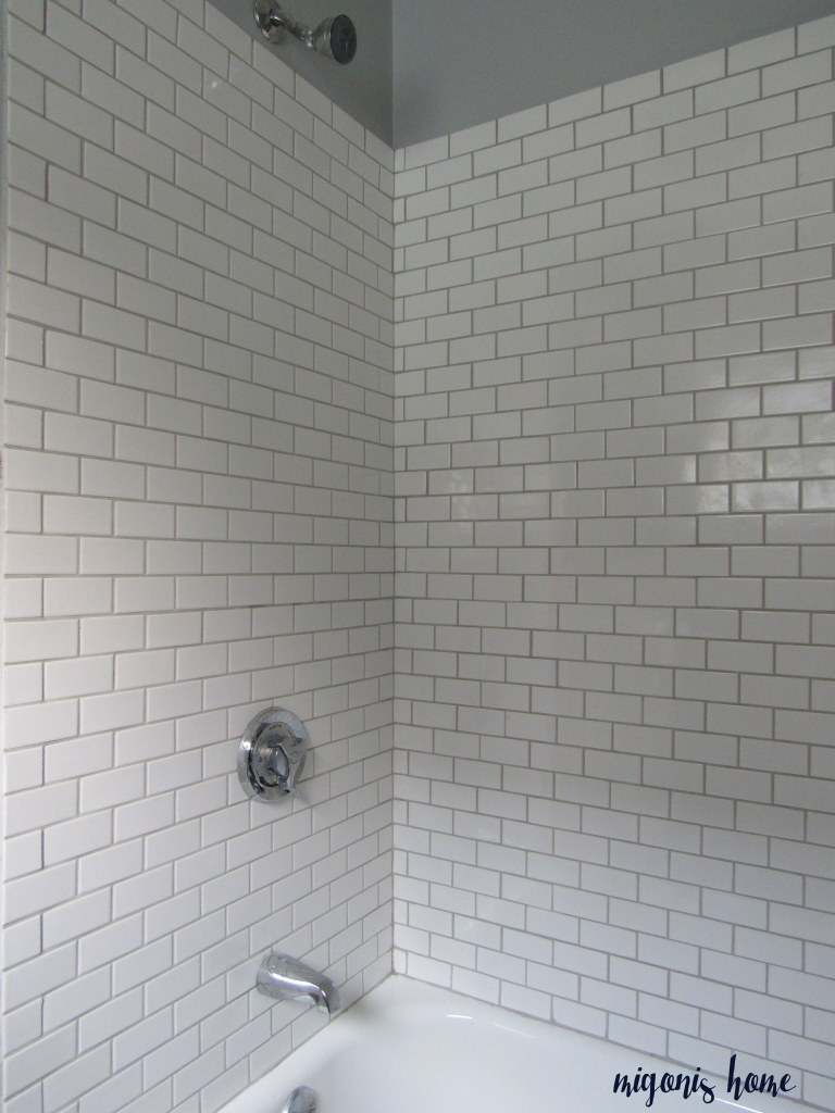 Things i wish wed done differently migonis home below is the photo of the flips tub done with oyster gray grout i love that simple and classic combo dailygadgetfo Gallery